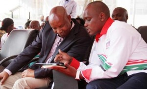 Director of Digital Media and Diaspora Communication Dennis Itumbi (right) shows Nakuru County Governor Kinuthia Mbugua the basics of Wi-Fi connectivity. Photo Courtesy of Nation Media