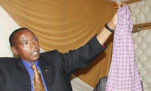 Mutula shows a skirt to the press after his controversial remarks Photo:CapitaL Fm