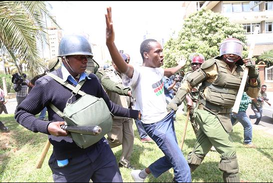 Francis Sakwa being manhandled by police officers at a past protest. The activist was arrested on Sunday, (Photo/ @InsecurityKE)
