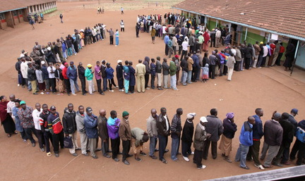 Kenyans wait in line to vote in 2013. (Photo/www.cleveland.com)