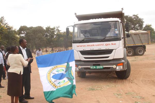 county executive for devlotion Kawive Wambua  and his education counterpart flag off relief food for pupils in areas hit by drought Photo:Governor's Press