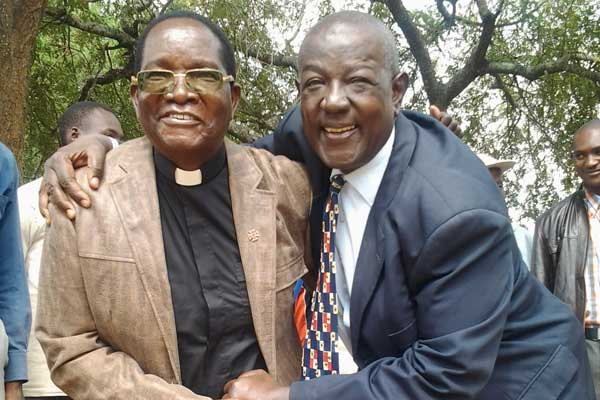 Fr.John Makewa and his Lawyer Fred Nemisi Photo:Nation