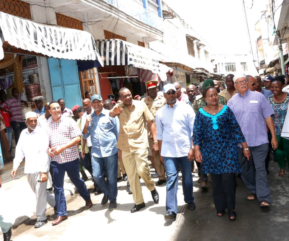 Governor Joho and other Mombasa leaders walk with President Kenyatta through the streets of old town