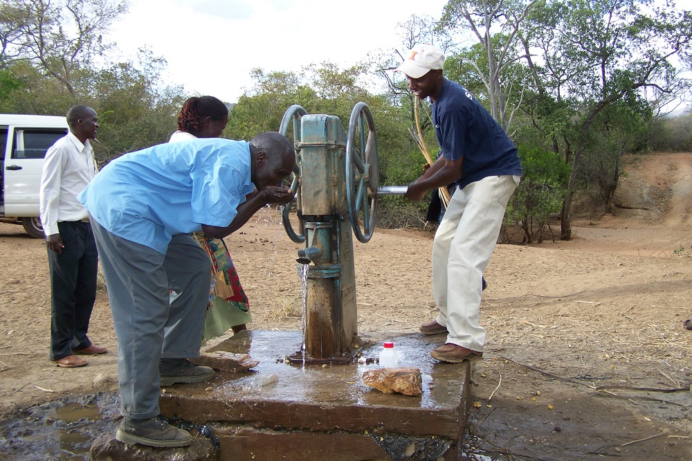 The writer (R) at one of the boreholes servicing the Pokot in the vast West Pokot District .[Photo: Solomon Mburu]