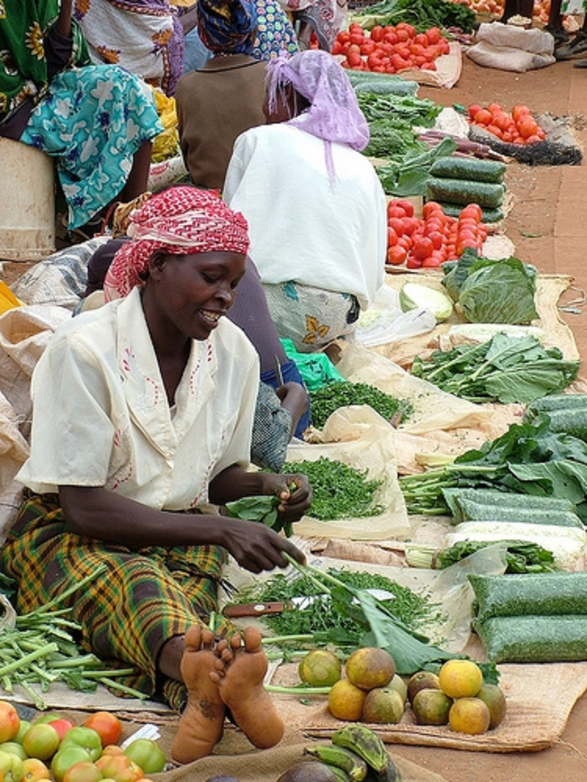 Mama Zubaida, as she is famously known sells vegetables at the open air market in Isiolo Town. [Photo: Malachi Motano]