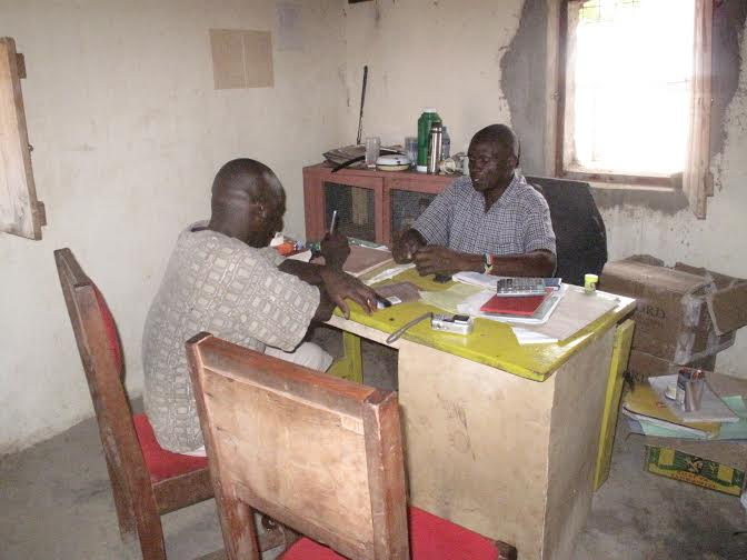 The writer with the head master. Human resources lack is also a challenge to education in this area. [Photo Malachi Motano]